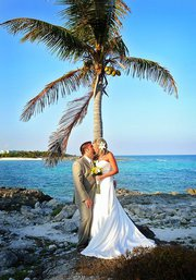 Grand Sirenis Riviera Maya Destination Wedding couple under the palm